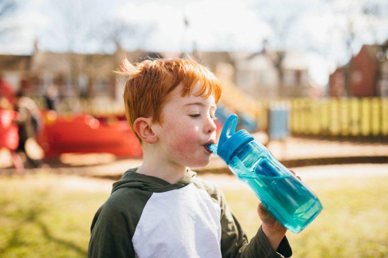 boy-drinking-water-in-park-optimised